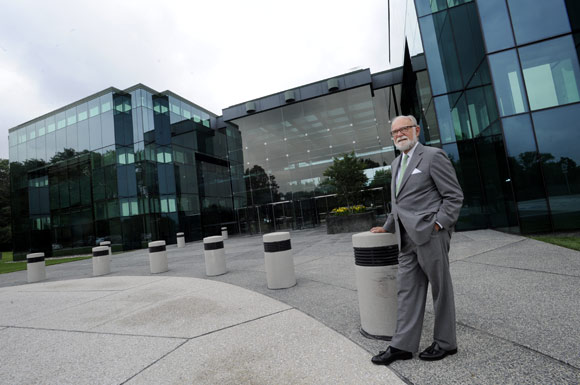 Architect William Schamu stands in front of the Marbury Building