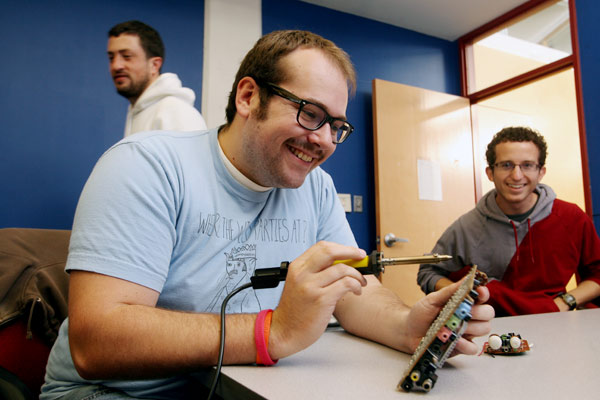 Mark Houston works on a project during Hackathon - Arianne Teeple